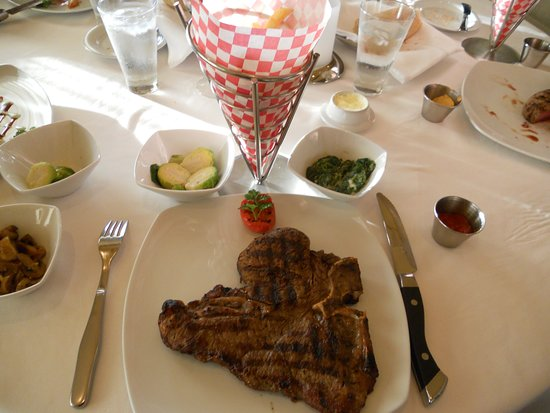Norwegian Gem: Porterhouse steak with creamed spinach, brussle sprouts, and truffle fries