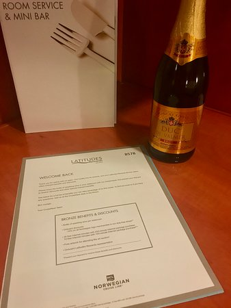 Norwegian Gem: Latitudes welcome letter and free sparkling wine