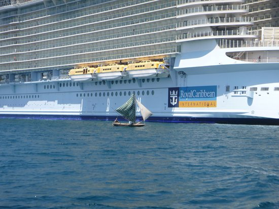 Oasis of the Seas: Sailboat in Haiti next to ship -  for perspective