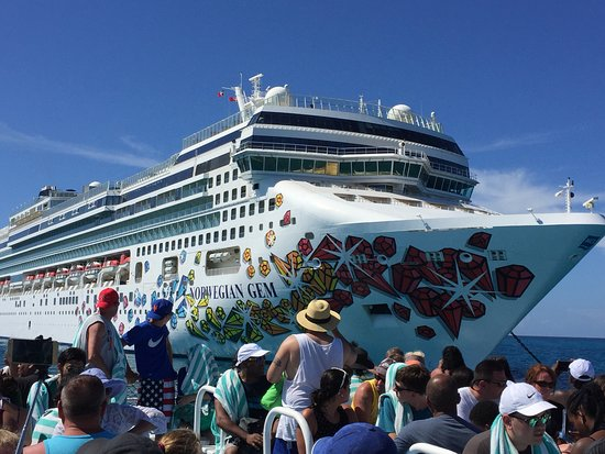 Norwegian Gem: From the tender to Great Stirup Cay. A fun destination- very hot! Get an umbrella!! Beach & water are very rocky! They need signs for the underwater sculpture garden. If I wasn