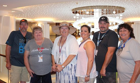 Norwegian Epic: Our group in front of the chandelier in the middle of the ship
