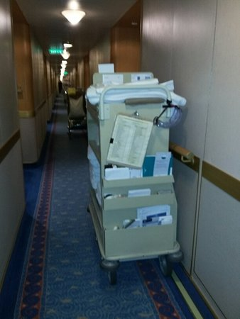 Ruby Princess: This is a cleaning cart that was left in the hallway for a large portion of