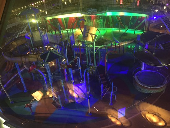 Liberty of the Seas: This is a view of the kids splash park area at night.