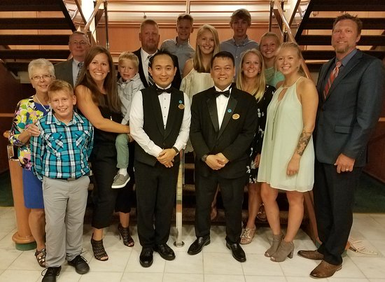 Ruby Princess: Our family with our waiter and assistant waiter on formal night.