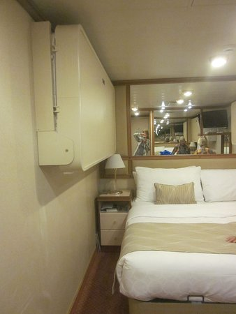 Emerald Princess: Sorry its on the side.  Showing the interior cabin with pull down bed for a