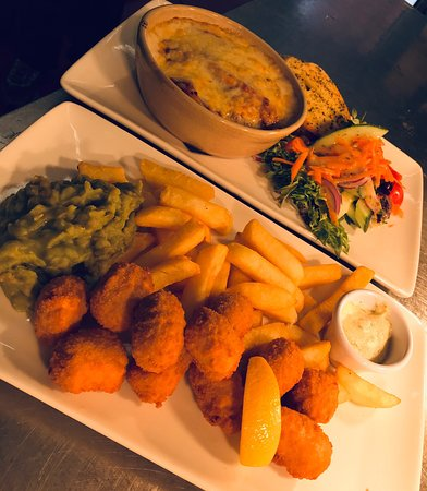 The Fishermens Rest: Hake supreme, wrapped in Parma ham, served with an Asparagus & Burst cherry tomato Risotto. Traditional Lasagne & Scampi with Homemade mushy peas.