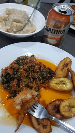 This is the melon seed and spinch stew with cassava solids, platano and a malt drink