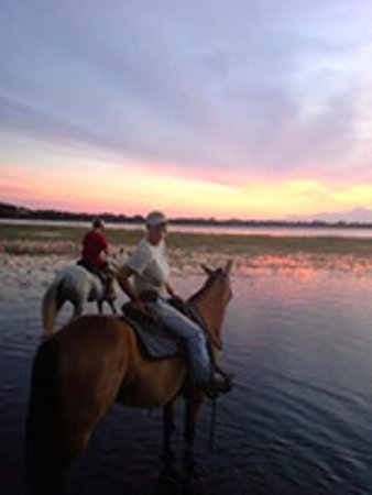 Donna and Jubilee enjoying a sunset trail ride