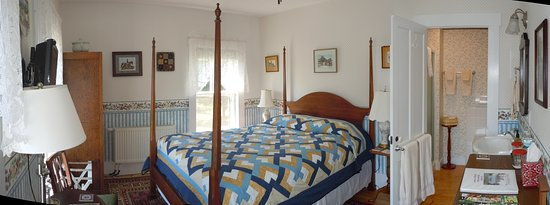 The Quebec Country Room has a queen bed, private bath with a shower, and views of the surrounding hills and mountains