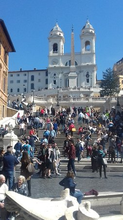 The Piazza with the Spanish Steps and the Trinità dei Monti at the back.