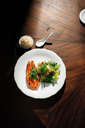 Grilled norwegian salmon with an acidic fresh salad and jasmine rice.