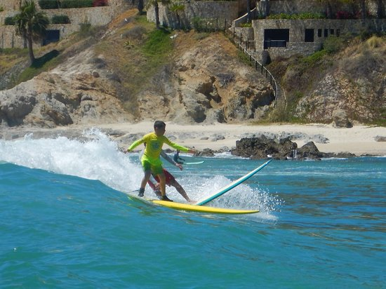 My 9 year old son (first-time surfer) confidently navigating the (at times crowded) waves!