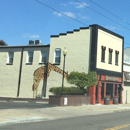 Cool giraffe mural on Barrel House exterior
