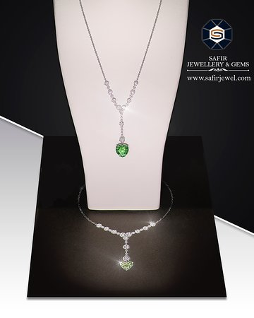 """Transformation of vizualization into tangible savour felt in charming necklace made of 13.45cts Paraiba and enriched by """"must-have"""" diamonds in 18K white gold."""