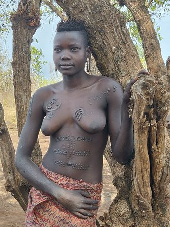 Southern Nations, Nationalities, and People's Region, เอธิโอเปีย: most tribe's in omo valley uses clarification as curifications  and beauty . This is a portrait of mursi tribes girl Ethiopia, come wonder