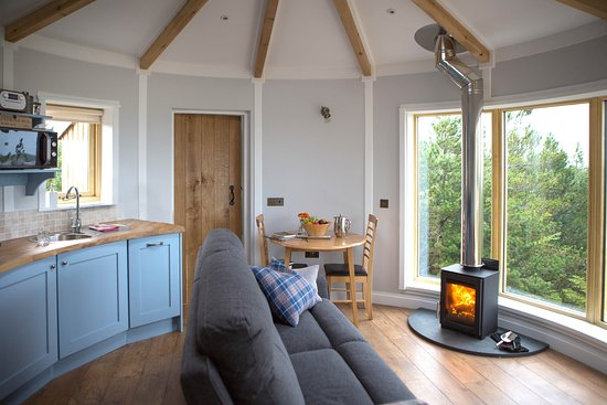 Kitchen with cooker, oven, dishwasher, microwave. Comfortable seating at dining table or reclining sofa to relax by the fire and gaze out to sea