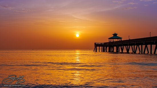 """Deerfield Beach's Pier is a beautifully balanced structure that helps to complement this beach's amazing environment.  I captured """"Morning Calm"""" on one of the most productive mornings I had in 2017. In this image, I tried to capture the perfect balance and warmth provided by this location.  Deerfield Beach Pier, September 30th, 2017 (7:25 am)"""