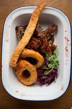 BBQ Butter Baby Back Ribs, Pickled Onion Rings.