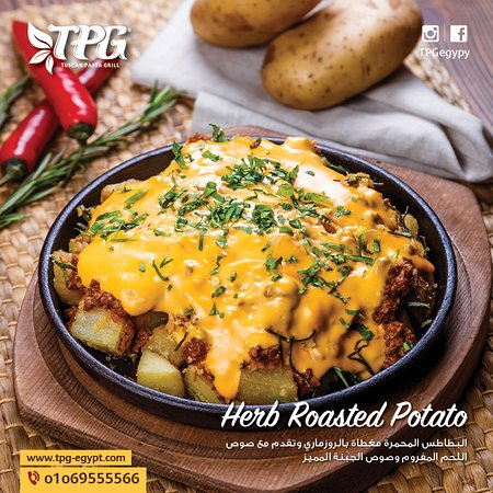Tpg: Herb roasted potato Roasted rosemary potato served with specail  spicy meat sauce and cheese sauce.