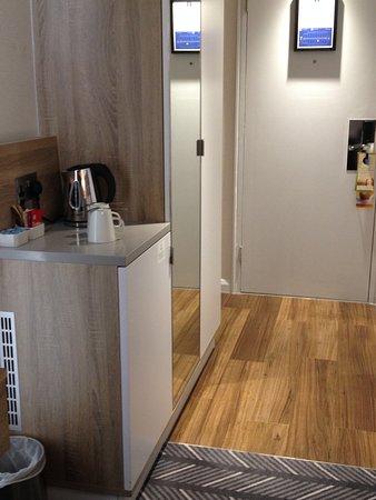 Fridge & entry with wardrobe in hallway