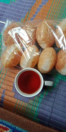 Bhutan: The cup of tea & home made snack make me happy man right after bed. What a treat!!!