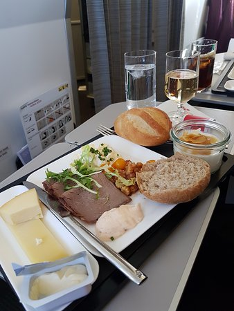 Swiss International Air Lines [SWISS]: Cold meat and cheese platter first leg (London to Zurich). Real porcelain plates and glass glasses and spotless cutlery.
