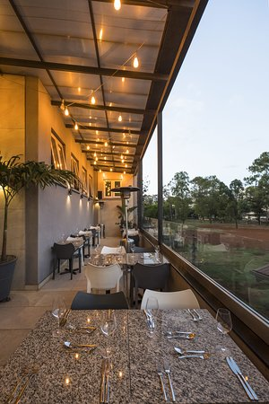Set up at dusk. The hanging bulbs give a warm feel to the terrace of the restaurant and In case it gets chilly we have lamps to warm you up!