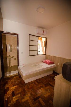 Apto simples econômico AR A, suite, tv, ar condicionado, internet 300 mb, cafe da manha completo, garagem.