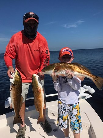 Mike & Wyatt with a great redfish day!
