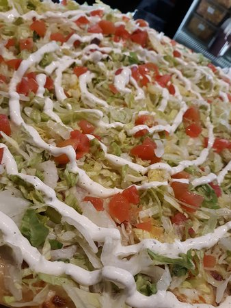 Our Picnic Pizza, like a Clubhouse Sub in pizza form, with jalapenos sprinkled on top for a little spice and red wine vinegar drizzled on top with our Famous Homemade Ranch for that added pop!