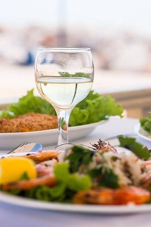 Molos Restaurant: White house wine and fresh salads.