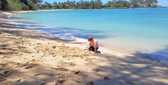 building sand castles at Kawela Bay