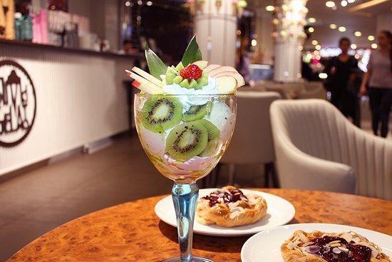 great delicious dessert of ice cream and kiwi