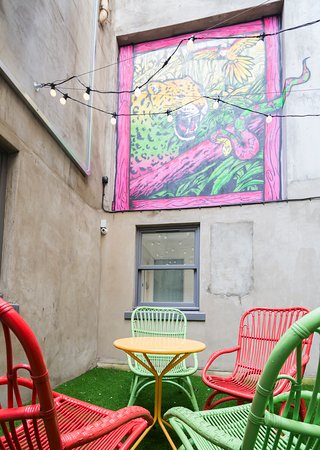 SoHostel London Court Yard - Chill zone complete with lights, seating and access to the games room!