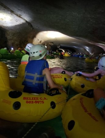Cave Tubing and Zipline from Belize City: Water level was low in April. We had to be pushed off the small rocky areas that were at the entrances