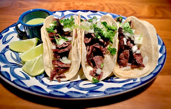 Cielo Cocina Mexciana: Carne Asada Tacos / Open flame grilled skirt steak  tacos served with lime and salsa verde