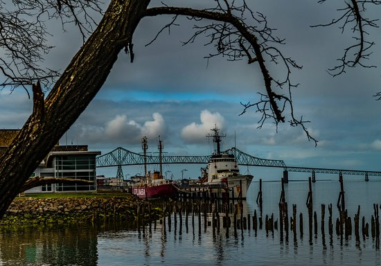 Astoria Megler Bridge in Background. Columbia and Coast Guard boats in foreground.