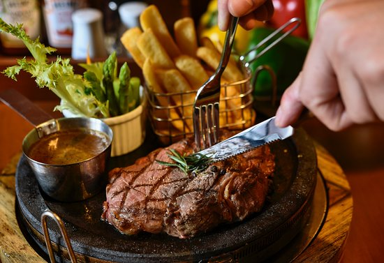 STONE-GRILLED STEAK Steak are grilled on hot stone... Guest can choose the ripe level of steak also... This is one of the famous dishes of V Station