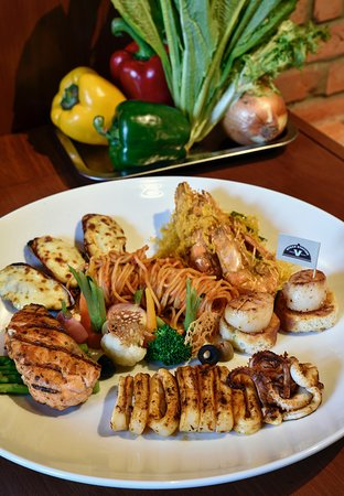 GRIILED MIX SEAFOOD Grilled fish, shrimp, mussel, squid, served with pasta Great choice for group guests...