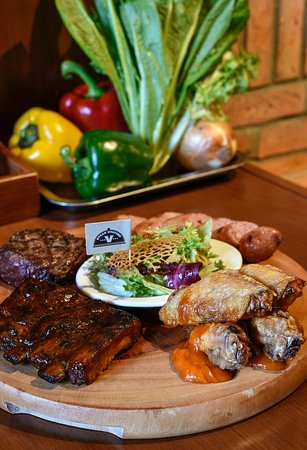 GRILLED MEAT COMBO Grilled steak, sausages, chicken wings, pork ribs, served with salad Great choice for group guests