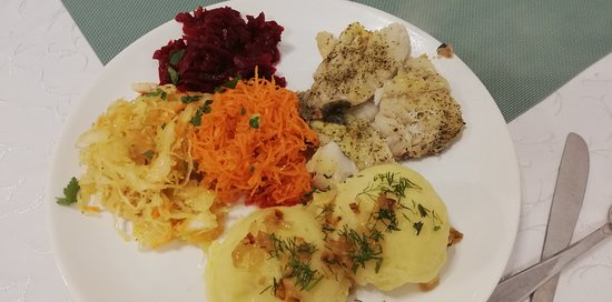 """Młynskie Danie: Typical daily set composed by meat (or fish, as in this case), smashed potatoes, and """"zestaw surowek"""" (set of raw salads)"""