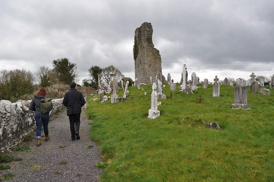 Boyne Valley Tours: Michael walking with us into a cemetery with ruins.
