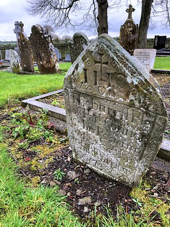 Boyne Valley Tours: Gravestone carved onto an irregular rock.