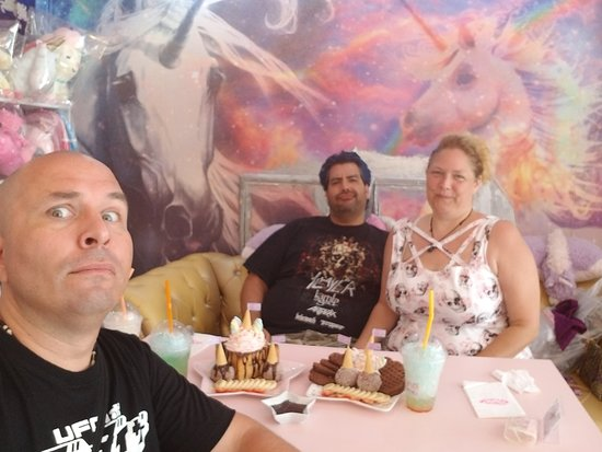Friends and I sitting down, pondering what is to come from eating all this sugar. :)