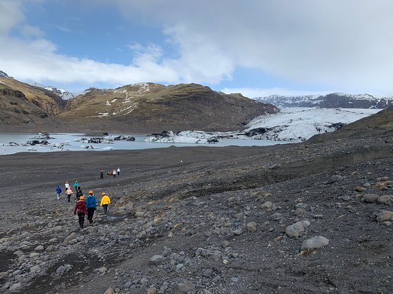 Walking across the moraine field to the snout of the glacier.