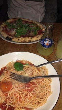 Pomodoro pasta and a prosciutto pizza