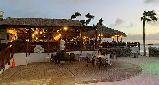 Sunset At The Sea Breeze Bar And Restaurant At The Holiday