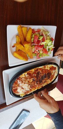 Lasagne with chips and salad