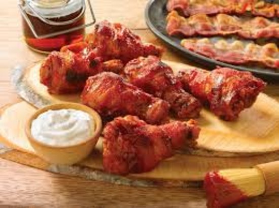 Bacon Wrapped Chicken Wings.  That's right you heard us right, as if our wings weren't already delicious, now we've wrapped them in bacon!!
