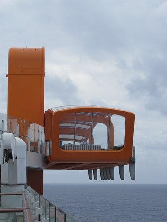 Celebrity Edge: This is the Magic Carpet, a part of the ship that extends out over the water and serves as a bar, a restaurant, and hang out area.